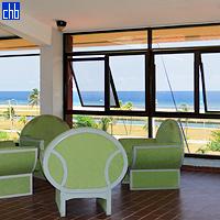В главном здании отеля Акуарио уютное лобби с креслами