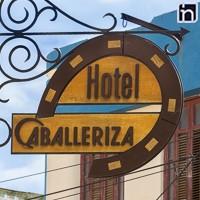 Sign Pointing Hotel Encanto Caballeriza, Holguin, Cuba