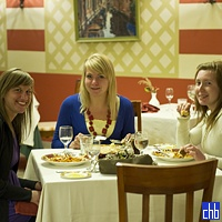 Canadian Girls Eating at El Arlequino Restaurant